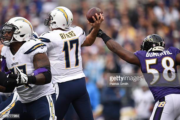 Outside linebacker Elvis Dumervil of the Baltimore Ravens tries to block a pass thrown by quarterback Philip Rivers of the San Diego Chargers in the...