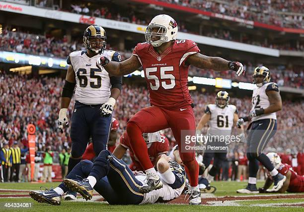 Outside linebacker John Abraham of the Arizona Cardinals reacts after a sacking quarterback Kellen Clemens of the St Louis Rams in the end zone for a...