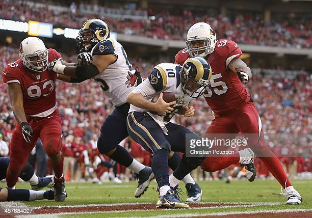 Outside linebacker John Abraham of the Arizona Cardinals sacks quarterback Kellen Clemens of the St Louis Rams in the end zone for a safety during...