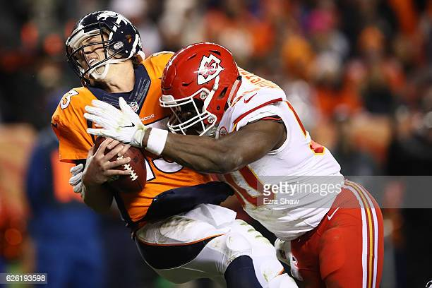 Outside linebacker Justin Houston of the Kansas City Chiefs sacks quarterback Trevor Siemian of the Denver Broncos for a safety in the second quarter...