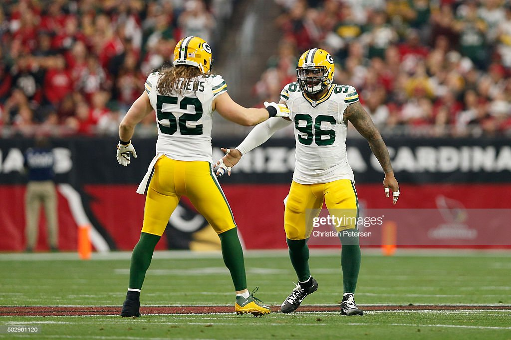 Outside linebacker <a gi-track='captionPersonalityLinkClicked' href=/galleries/search?phrase=Mike+Neal+-+American+Football+Player&family=editorial&specificpeople=11464524 ng-click='$event.stopPropagation()'>Mike Neal</a> #96 of the Green Bay Packers high fives inside linebacker Clay Matthews #52 during the NFL game against the Arizona Cardinals at the University of Phoenix Stadium on December 27, 2015 in Glendale, Arizona. The Cardinals defeated the Packers 38-8.