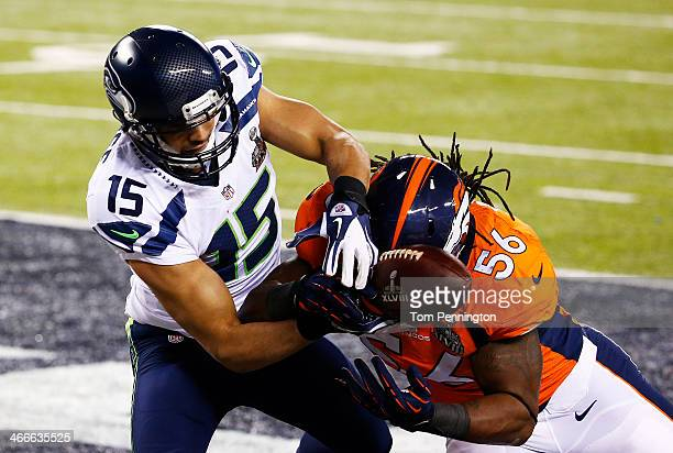 Outside linebacker Nate Irving of the Denver Broncos breaks up a pass in the endzone to wide receiver Jermaine Kearse of the Seattle Seahawks during...
