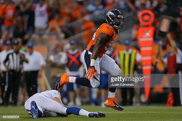 Outside linebacker Nate Irving of the Denver Broncos celebrates a sack of quarterback Andrew Luck of the Indianapolis Colts in the second quarter of...