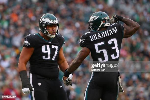 Outside linebacker Nigel Bradham of the Philadelphia Eagles celebrates his sack with teammate defensive tackle Destiny Vaeao against the Denver...