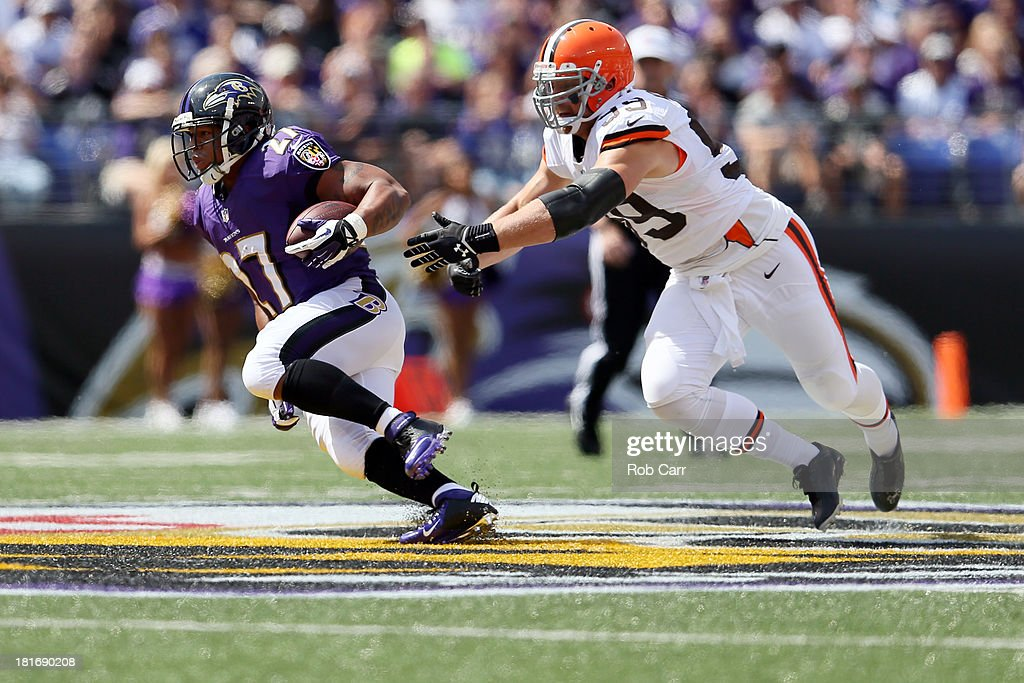 Outside linebacker Paul Kruger #99 of the Cleveland Browns tackles running back Ray Rice #27 of the Baltimore Ravens at M&T Bank Stadium on September 15, 2013 in Baltimore, Maryland.