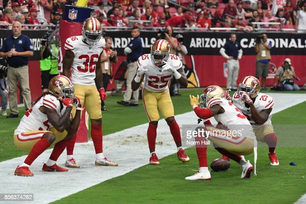 Outside linebacker RayRay Armstrong of the San Francisco 49ers reacts with teammates cornerback Dontae Johnson cornerback Jimmie Ward free safety...