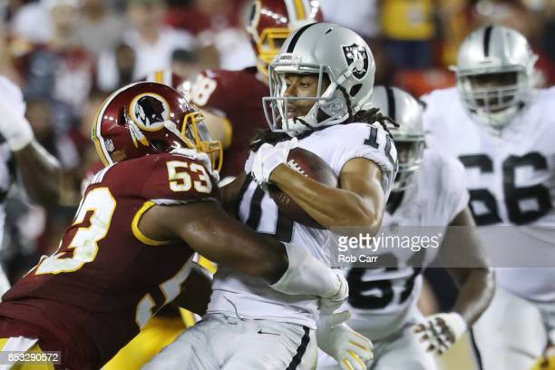 Outside linebacker Ryan Anderson tackles wide receiver Seth Roberts of the Oakland Raiders at FedExField on September 24 2017 in Landover Maryland
