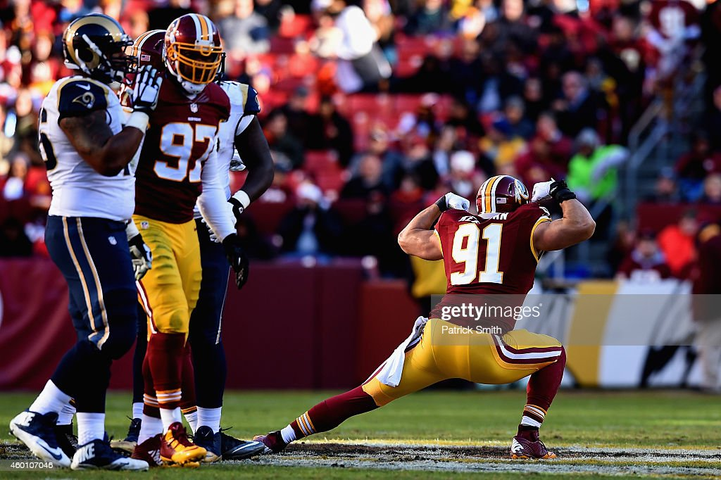 Outside linebacker Ryan Kerrigan of the Washington Redskins celebrates following a sack in the second quarter of a game against the St Louis Rams at...