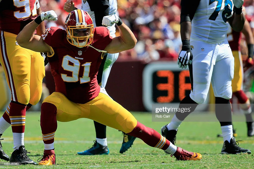 Outside linebacker Ryan Kerrigan of the Washington Redskins celebreates after recording a second quarter sack during a game against the Jacksonville...