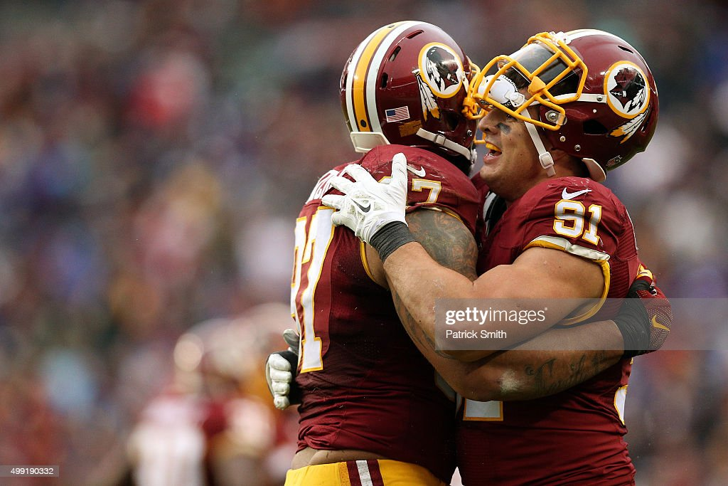 Outside linebacker Ryan Kerrigan of the Washington Redskins and defensive end Jason Hatcher of the Washington Redskins react after a play against the...
