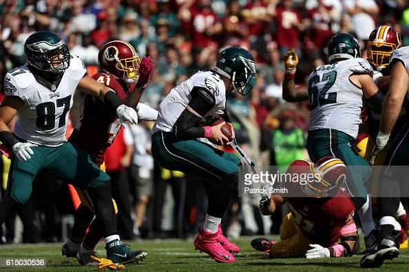 Outside linebacker Ryan Kerrigan of the Washington Redskins pulls on the jersey of quarterback Carson Wentz of the Philadelphia Eagles in the first...