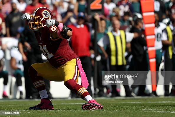 Outside linebacker Ryan Kerrigan of the Washington Redskins reacts after sacking quarterback Carson Wentz of the Philadelphia Eagles in the first...