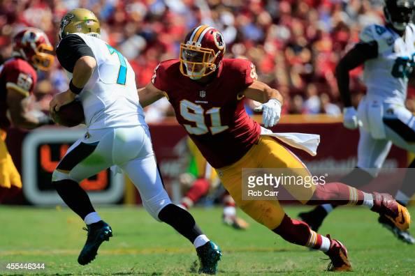 Outside linebacker Ryan Kerrigan of the Washington Redskins sacks quarterback Chad Henne of the Jacksonville Jaguars during the second quarter at...