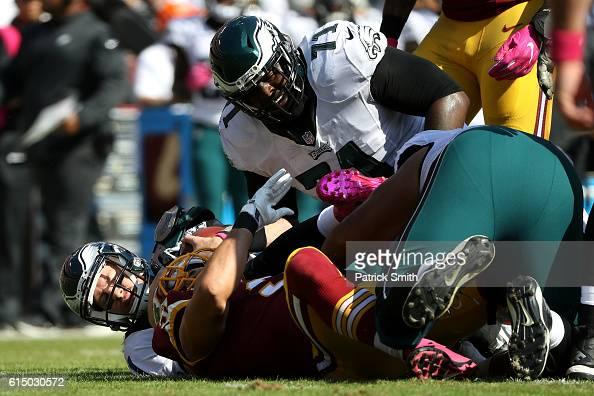 Outside linebacker Ryan Kerrigan of the Washington Redskins sacks quarterback Carson Wentz of the Philadelphia Eagles in the first quarter at...