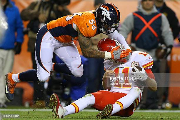 Outside linebacker Shane Ray of the Denver Broncos tackles quarterback Alex Smith of the Kansas City Chiefs in the third quarter of the game at...