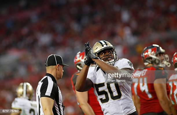 Outside linebacker Stephone Anthony of the New Orleans Saints celebrates after running back Doug Martin of the Tampa Bay Buccaneers is stopped for a...