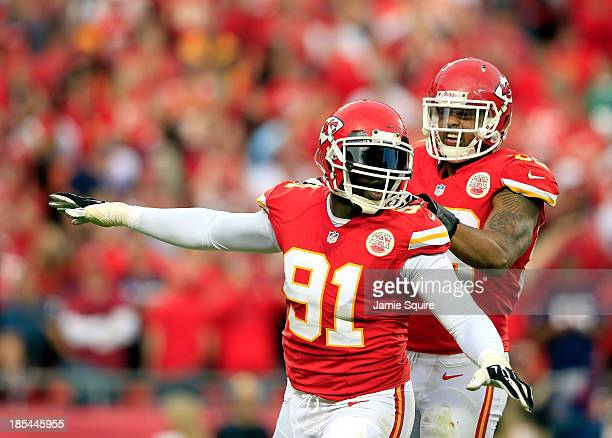 Outside linebacker Tamba Hali of the Kansas City Chiefs is congratulated by inside linebacker Derrick Johnson after sacking quarterback Case Keenum...