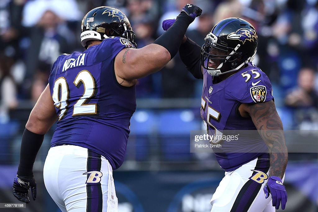 Outside linebacker <a gi-track='captionPersonalityLinkClicked' href=/galleries/search?phrase=Terrell+Suggs&family=editorial&specificpeople=215464 ng-click='$event.stopPropagation()'>Terrell Suggs</a> #55 of the Baltimore Ravens celebrates a sack with teammate <a gi-track='captionPersonalityLinkClicked' href=/galleries/search?phrase=Haloti+Ngata&family=editorial&specificpeople=622374 ng-click='$event.stopPropagation()'>Haloti Ngata</a> #92 against the San Diego Chargers in the second half at M&T Bank Stadium on November 30, 2014 in Baltimore, Maryland. The San Diego Chargers won, 34-33.
