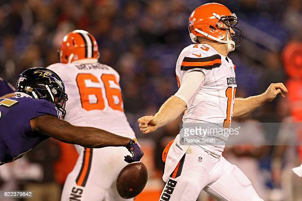 Outside linebacker Terrell Suggs of the Baltimore Ravens forces a fumble on quarterback quarterback Josh McCown of the Cleveland Browns in the second...