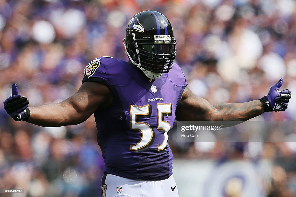 Outside linebacker <a gi-track='captionPersonalityLinkClicked' href=/galleries/search?phrase=Terrell+Suggs&family=editorial&specificpeople=215464 ng-click='$event.stopPropagation()'>Terrell Suggs</a> #55 of the Baltimore Ravens motions to the crowd during the second half of the Ravens 14-6 win over the Cleveland Browns at M&T Bank Stadium on September 15, 2013 in Baltimore, Maryland.