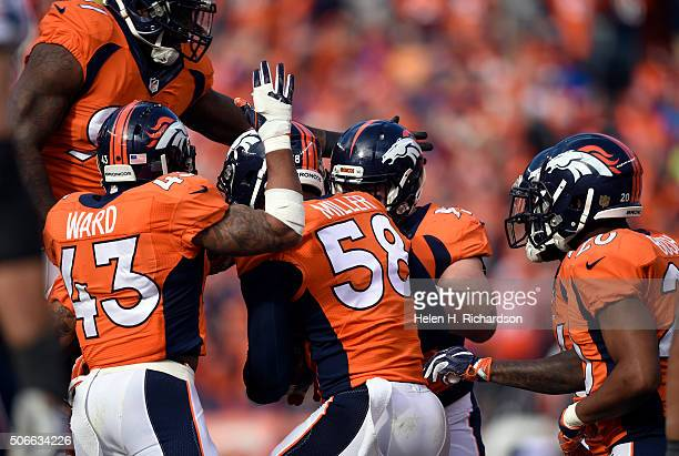 Outside linebacker Von Miller of the Denver Broncos celebrates with the defense after pulling in an interception in the second quarter The Denver...