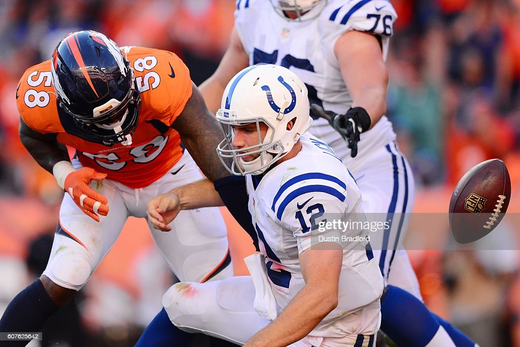 Outside linebacker Von Miller #58 of the Denver Broncos strips the ball from quarterback Andrew Luck #12 of the Indianapolis Colts in the fourth quarter of the game at Sports Authority Field at Mile High on September 18, 2016 in Denver, Colorado.