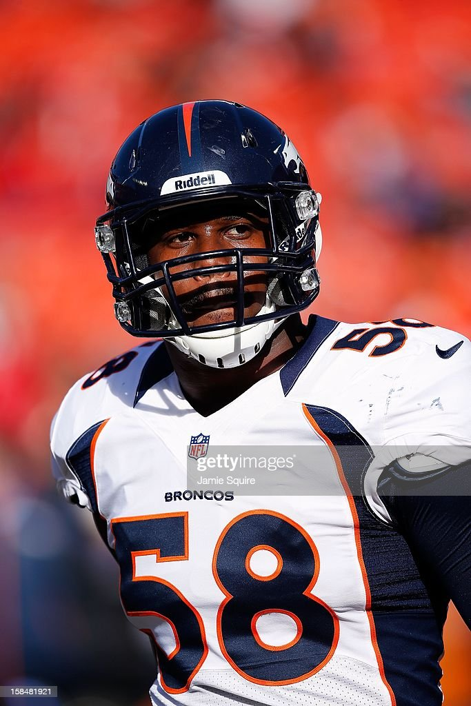 Outside linebacker <a gi-track='captionPersonalityLinkClicked' href=/galleries/search?phrase=Von+Miller&family=editorial&specificpeople=7125735 ng-click='$event.stopPropagation()'>Von Miller</a> #58 of the Denver Broncos walks onto the field during player warm-ups prior to the game against the Kansas City Chiefs at Arrowhead Stadium on November 25, 2012 in Kansas City, Missouri.