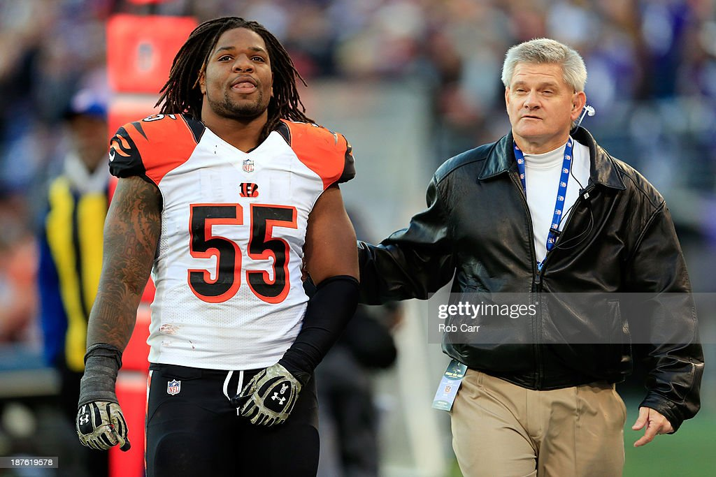 Outside linebacker <a gi-track='captionPersonalityLinkClicked' href=/galleries/search?phrase=Vontaze+Burfict&family=editorial&specificpeople=7173056 ng-click='$event.stopPropagation()'>Vontaze Burfict</a> #55 of the Cincinnati Bengals is walked off the field during the fourth quarter of the Bengals and Baltimore Ravens game at M&T Bank Stadium on November 10, 2013 in Baltimore, Maryland.