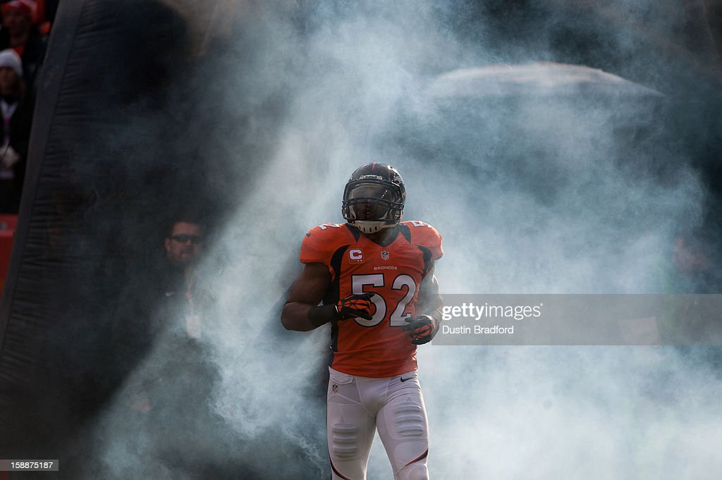 Outside linebacker Wesley Woodyard #52 of the Denver Broncos is surrounded by smoke as he emerges from the tunnel before a game against the Kansas City Chiefs at Sports Authority Field at Mile High on December 30, 2012 in Denver, Colorado. The Broncos defeated the Chiefs 38-3.