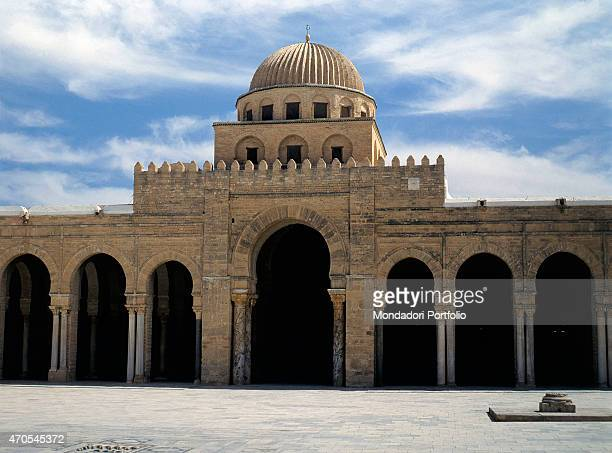 'Outside of Prayer Hall at Kairouan's Great Mosque by Aghlabid craftmen from 836 9th Century brickwork and stones Tunisia Kairouan Whole artwork view...