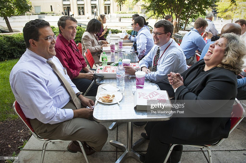 Outside table space was at a premium as federal workers were back on the job and the cafeteria at the GSA building across the street was not open because it did not have any supplies Thursday October 17, 2013 in Washington, DC. From left at the first two tables are, Nasr Fahmy, Lon McDougal, Jeff Mitchell and Sonya Dimas, all federal workers.
