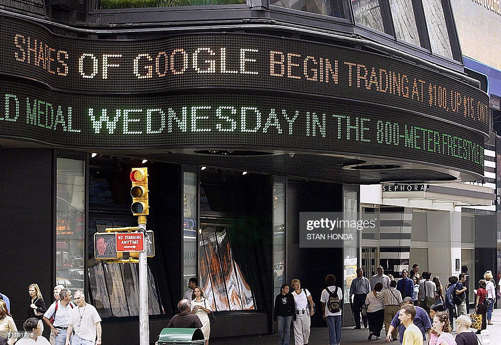 Outside the ABC News studios, a news zipper flashes a report on Google stock shares in New York's Times Square after trading started, 19 August, 2004, on the Nasdaq stock exchange. Google, making the biggest Internet float since the 1990s technology bubble, opened at 100.01 USD. Within an hour, more than 12 million shares had changed hands. The world's leading Internet search engine spiked to 103.42 USD and was trading early afternoon at 103.15 USD, valuing the entire company at 28 billion dollars. AFP PHOTO/Stan HONDA