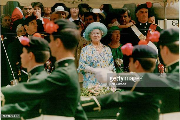 Outside the McCord Museum the Queen mother watch the black water regiment march past