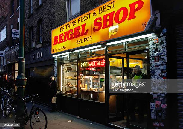 CONTENT] Outside the original bagel or 'beigel' shop in Brick Lane East London It is early evening and a policeman is coming out the door A lady is...