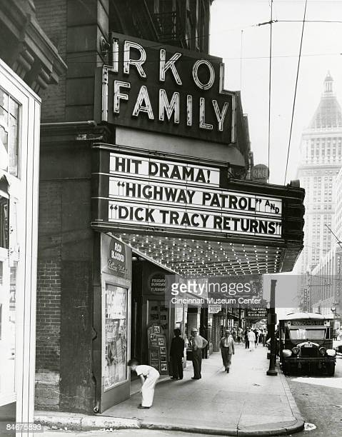 Outside the RKO Family theater a young boy leans in to take a closer look at the movie poster Cincinnati OH 1930 The marquee shows that the films...