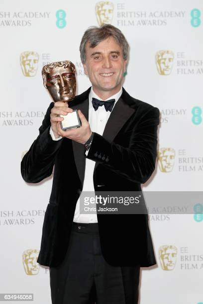 Outstanding British Contribution to Cinema Award winner Philip Knatchbull poses with his award in the winners room during the 70th EE British Academy...