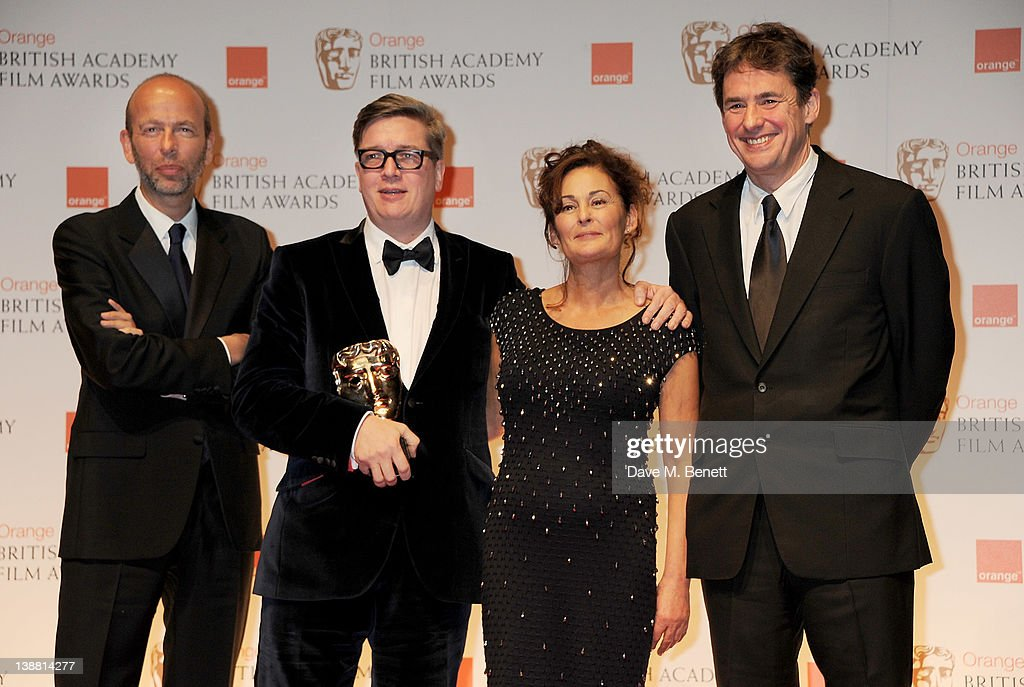 Outstanding British Film winners Tomas Alfredson Tim Bevan Eric Fellner and Robyn Slovo pose in the press room at the Orange British Academy Film...