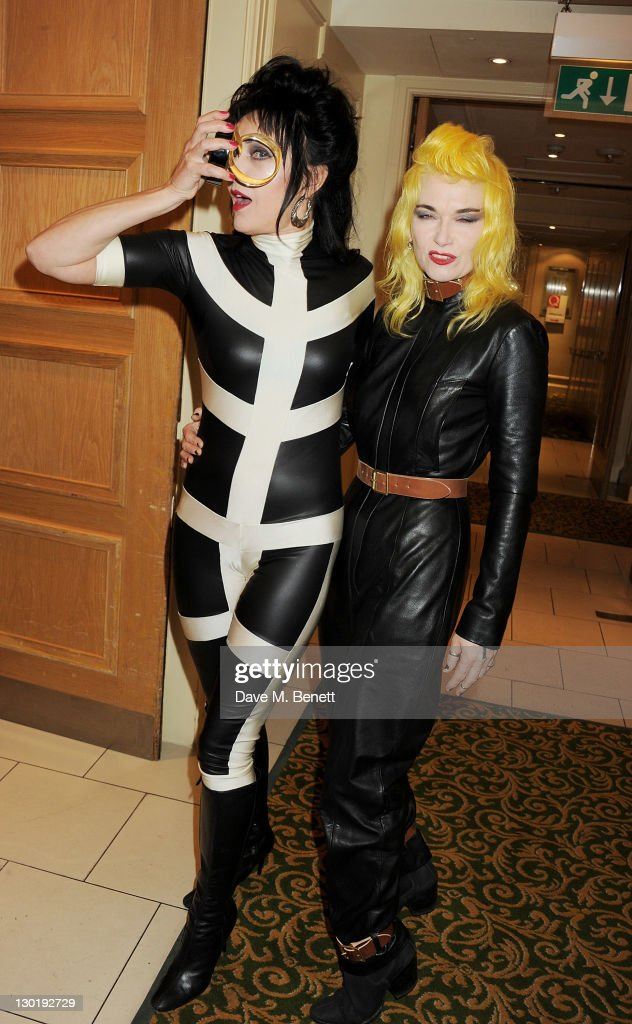 Q Outstanding Contribution To Music Winner <a gi-track='captionPersonalityLinkClicked' href=/galleries/search?phrase=Siouxsie+Sioux&family=editorial&specificpeople=714537 ng-click='$event.stopPropagation()'>Siouxsie Sioux</a> (L) and Pam Hogg pose in the press room at the Q Awards 2011 held at The Grosvenor House Hotel on October 24, 2011 in London, England.