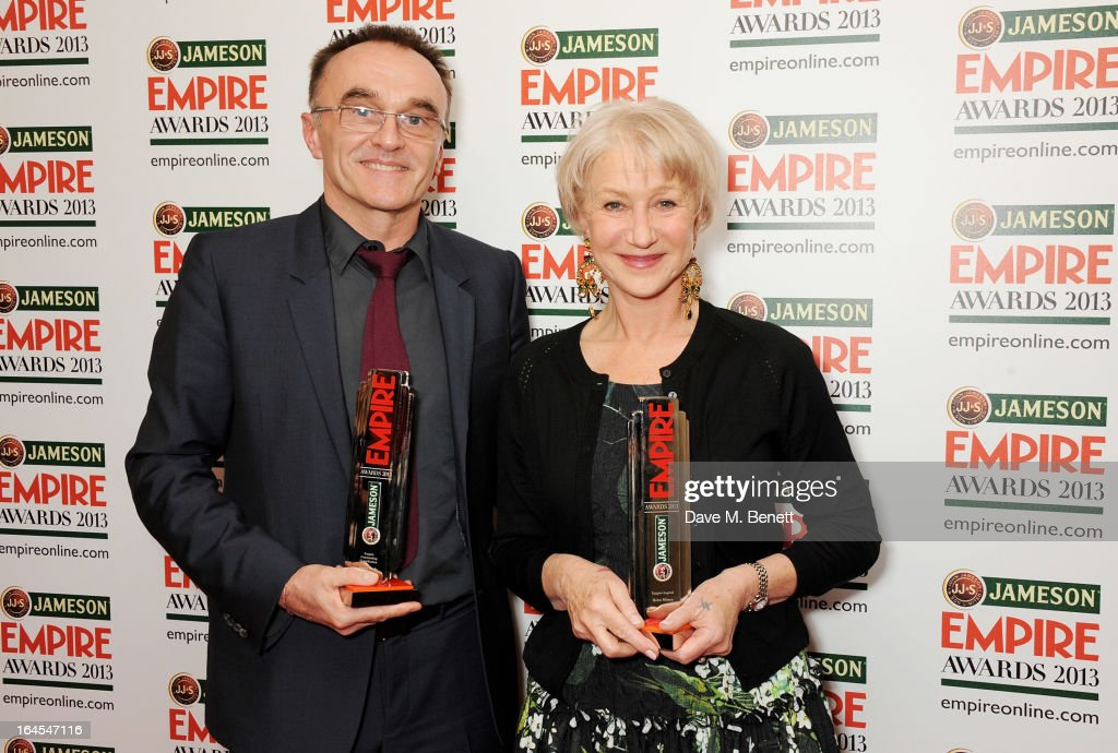 Outstanding Contribution winner Danny Boyle (L) and Empire Legend winner Dame Helen Mirren pose in the press room at the Jameson Empire Awards 2013 at The Grosvenor House Hotel on March 24, 2013 in London, England.