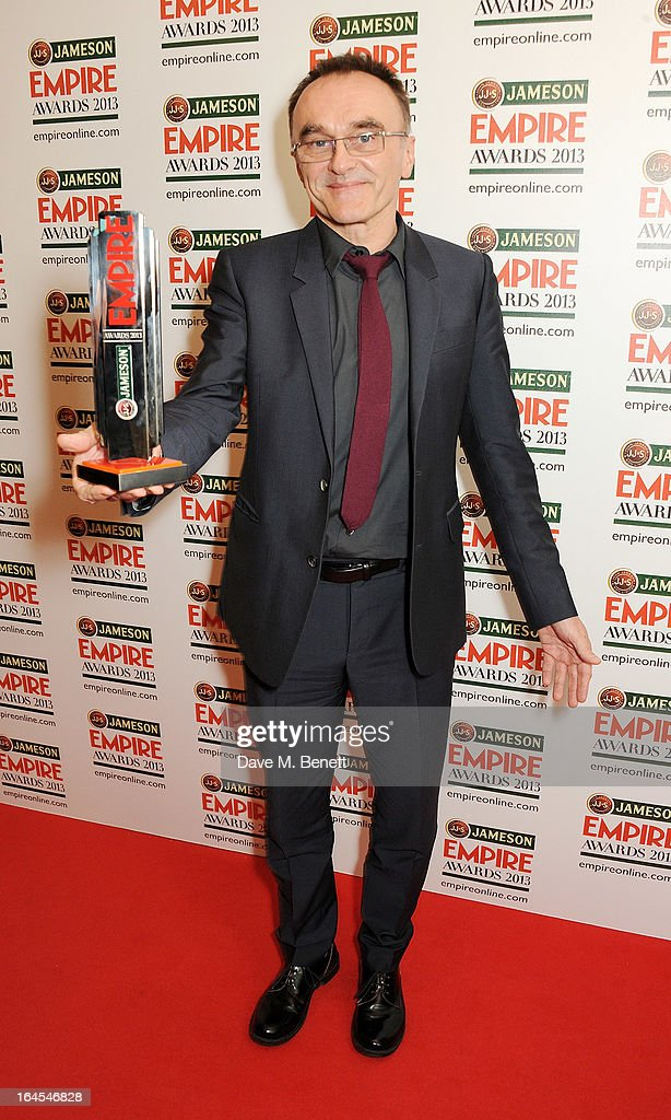 Outstanding Contribution winner Danny Boyle poses in the press room at the Jameson Empire Awards 2013 at The Grosvenor House Hotel on March 24, 2013 in London, England.