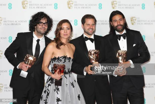 Outstanding Debut by a British Writer Director or Producer Award winners Babak Anvari Emily Leo Oliver Roskill and Lucan Toh pose in the winners room...