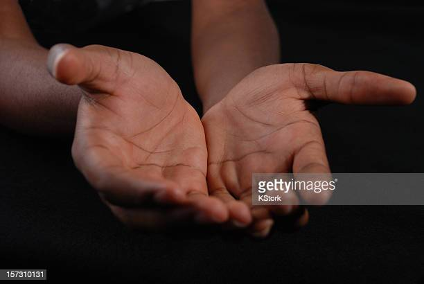 Outstretched hands of a Young Black Man
