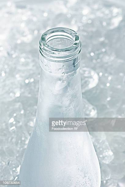 Ouzo in icy bottle, close-up