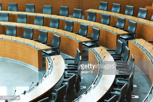 Oval conference room with rows of seats