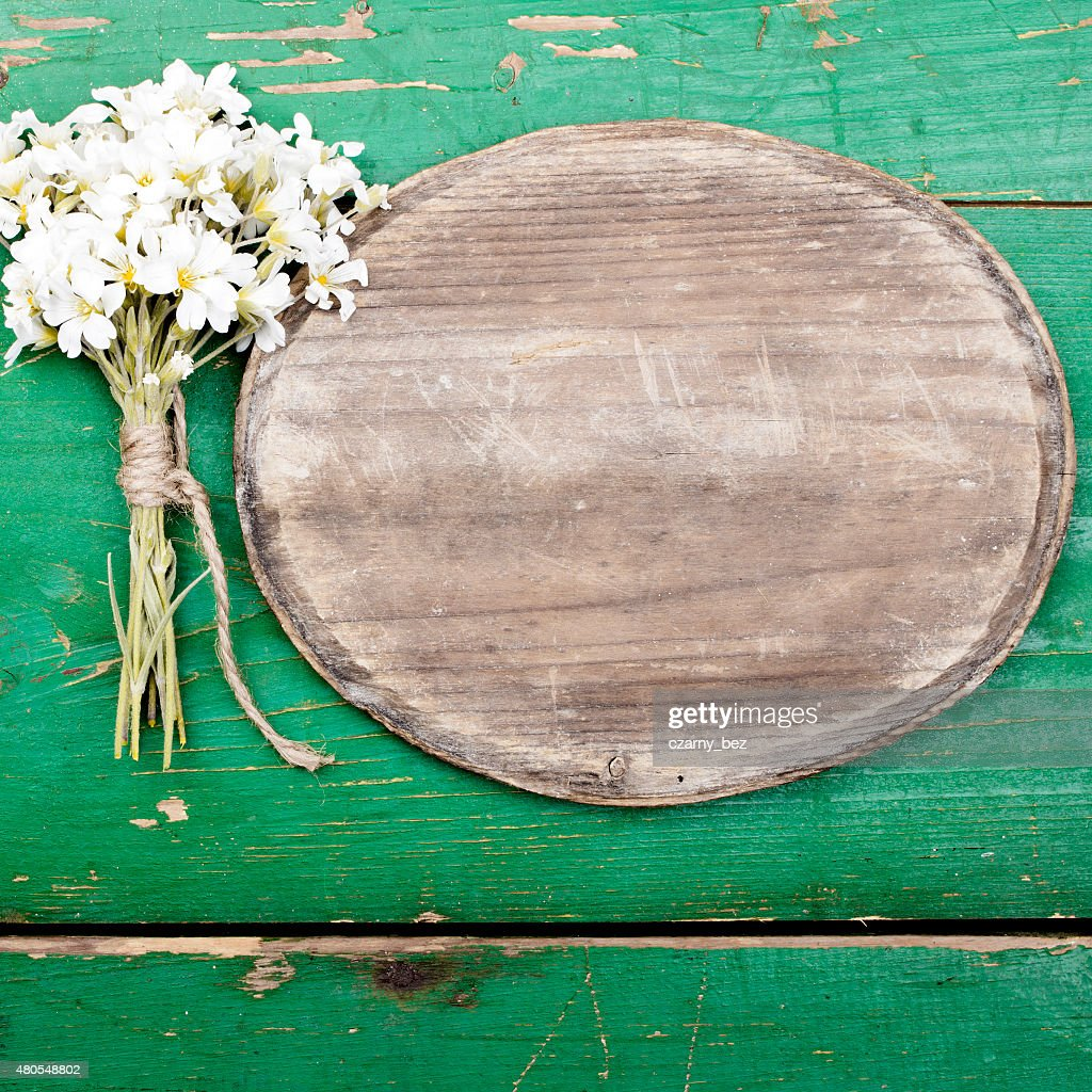 Oval plaque and a bouquet of flowers : Stock Photo