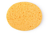 Oval yellow sponge cleansing puff for face or cleaning surface texture isolated on white background on top view