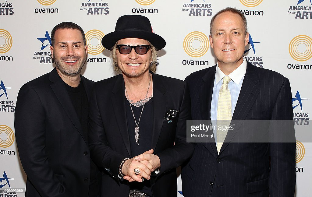 Ovation Chief Creative Officer Rob Weiss, musician <a gi-track='captionPersonalityLinkClicked' href=/galleries/search?phrase=Matt+Sorum&family=editorial&specificpeople=213836 ng-click='$event.stopPropagation()'>Matt Sorum</a>, and Ovation CEO Charles Segars pose for a photo backstage at The Nancy Hanks Lecture on Art and Public Policy sponsored by Ovation at John F. Kennedy Center for the Performing Arts on April 8, 2013 in Washington, DC.