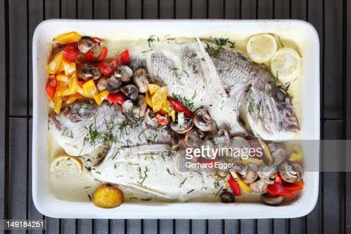 Oven baked fish : Stock Photo