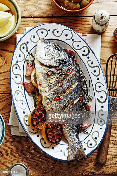 oven roasted fish on platter on table
