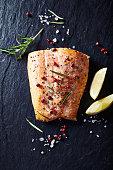 Oven-roasted salmon fillet on a black slate